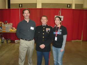 <br />Advisor Jeff Quinlan and member Emily Cauthen at Toys for Tots event